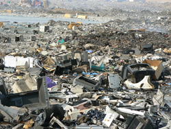large landfill of e-waste items being improperly discarded